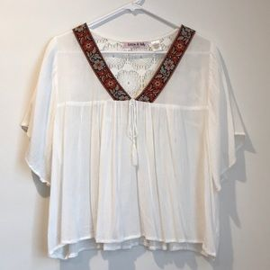 white flowy blouse with embroidery and lace